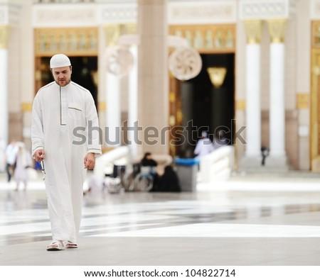 Muslim walking in Medina mosque outdoor - stock photo