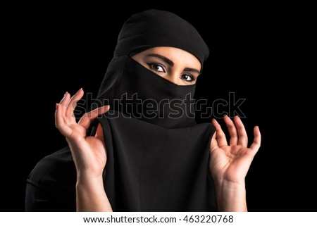 Muslim woman covering face