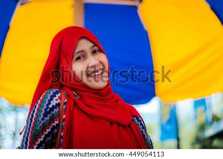 Muslim woman from Indonesia travel to an amusement park in Canada