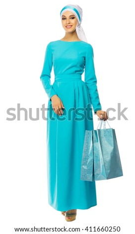 Muslim woman in blue dress with bags isolated - stock photo