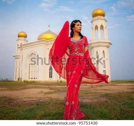 Muslim woman in front of the Mosque - stock photo