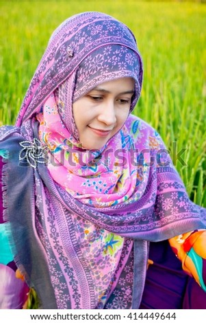 Muslim woman playing on paddy field in a village at Indonesia - stock photo