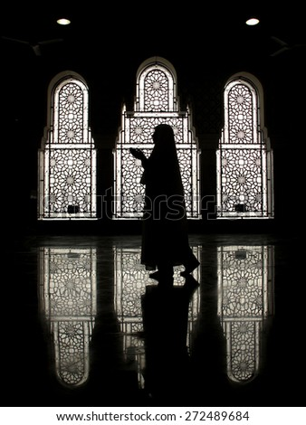 Muslim woman praying - stock photo
