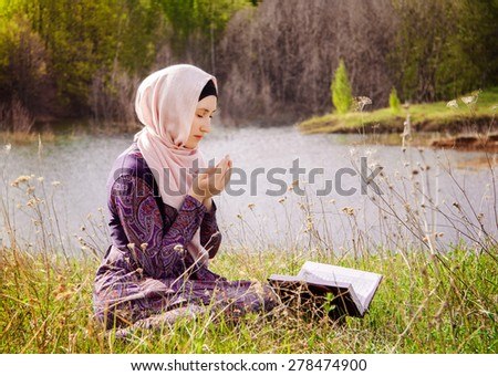 Muslim Woman Reading Holy Quran - stock photo