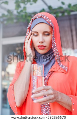 muslim woman suffering from thirst on ramadan - stock photo
