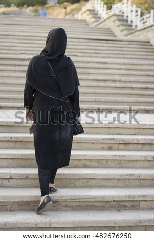 Muslim Woman Walking up Stairs on Outdoor, Back view