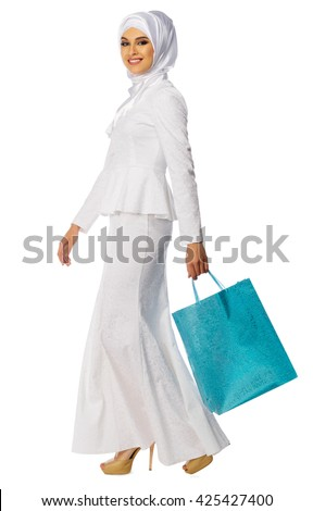Muslim woman with bag isolated - stock photo