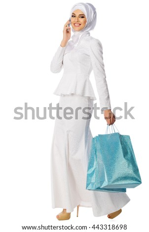 Muslim woman with bags isolated - stock photo