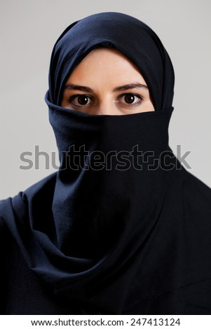 Muslim woman with big dark eyes, vertical