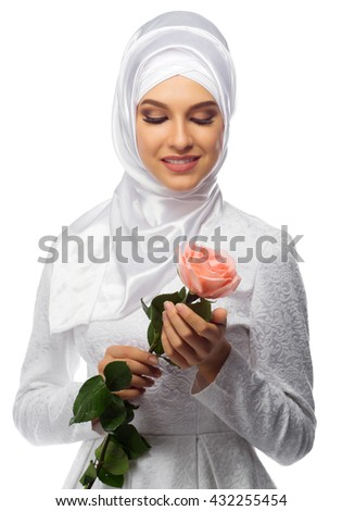 Muslim woman with rose flower isolated - stock photo