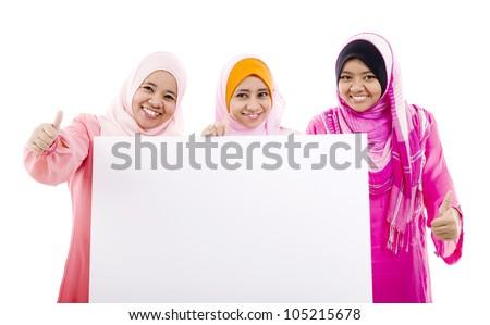 Muslim women holding a white board - stock photo