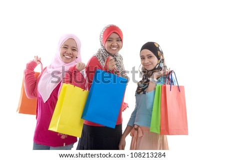 muslim women with shopping bags - stock photo
