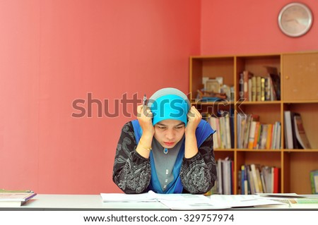 Muslim women working at office with stressful emotion - stock photo