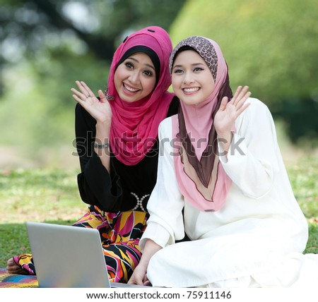Muslim young woman in head scarf say bye to they friends