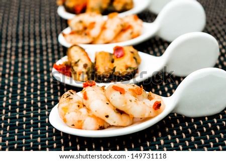 Mussel and Shrimp with white wine sauce on table  - stock photo