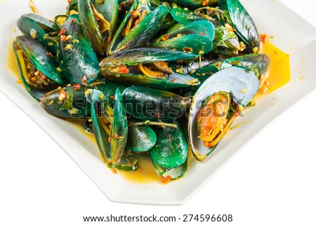 Mussel ,Fragrant fried mussels with basil and spicy with chili ,Thai food. - stock photo