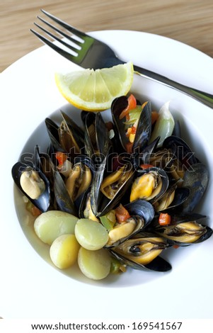 Mussels and potatoes on a plate