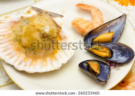 Mussels and scallops appetizer with shrimp - stock photo