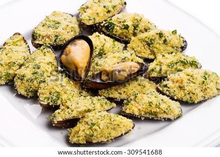 mussels au gratin  - stock photo