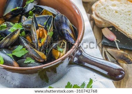 Mussels cooked in white wine sauce - stock photo