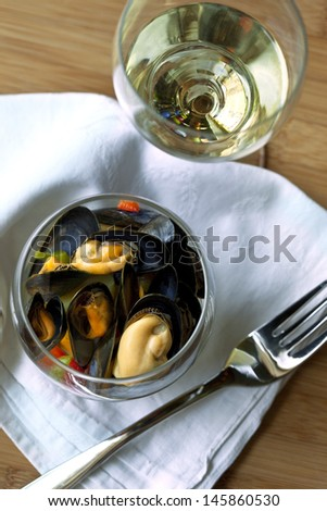 Mussels in a glass, glass of white wine - stock photo