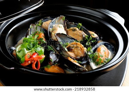 Mussels in coconut milk with lemongrass and fresh cilantro - stock photo