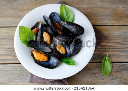 Mussels in sauce, top view - stock photo