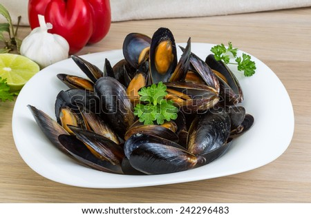 Mussels in the bowl with parsley branch
