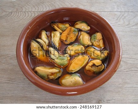 Mussels in typical sauce homemade pickled galician