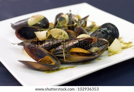 Mussels on the white plate prepared to eat