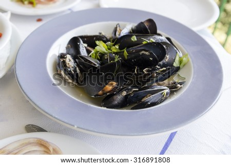 mussels plate table - stock photo