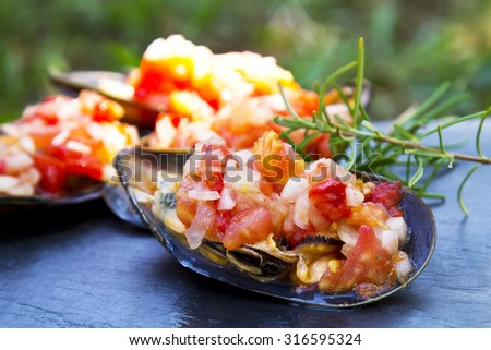 mussels vinaigrette on board - stock photo
