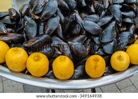 Mussels with lemon as street food in Cannakkale, Turkey - stock photo