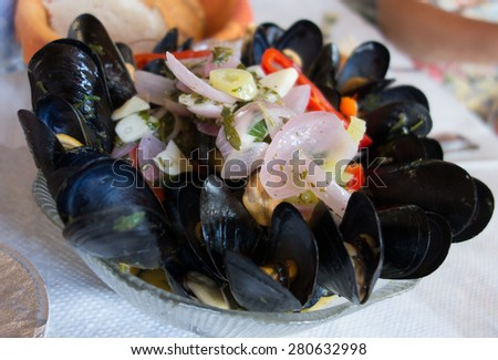 mussels with onions - stock photo