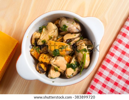 Mussels with parsley and garlic. - stock photo