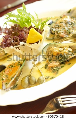 Mussels with salad - stock photo