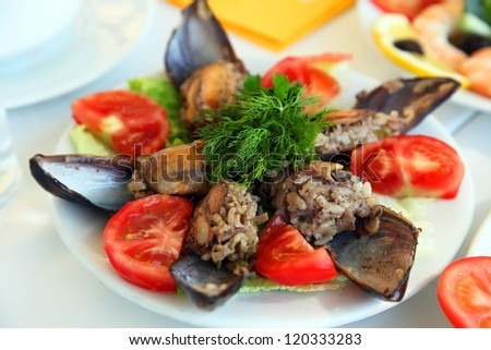 Mussels with tomato on the restaurant table in Buyukada, Istanbul Turkey.