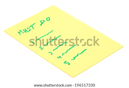 Must Do list in yellow paper - stock photo