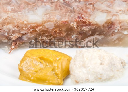 mustard and horseradish - typical seasonings for aspic aspic on white plate close up - stock photo