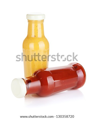Mustard and ketchup glass bottles. Isolated on white background - stock photo