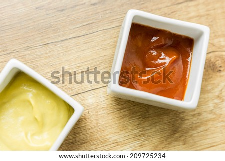 Mustard And Ketchup Sauce In White Bowl - stock photo