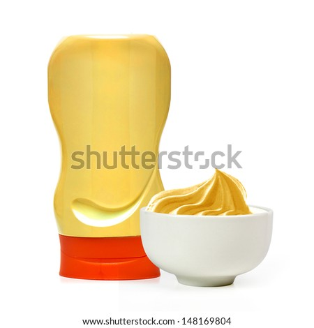 Mustard in bowl and bottle on white background - stock photo