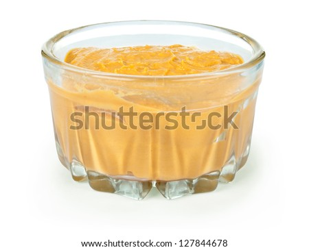 Mustard in glass bowl isolated on white