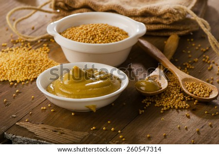 Mustard  on a  old  wooden table.  Selective focus - stock photo