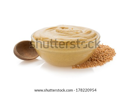 mustard sauce in bowl isolated on white background - stock photo