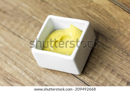 Mustard Sauce In White Bowl - stock photo