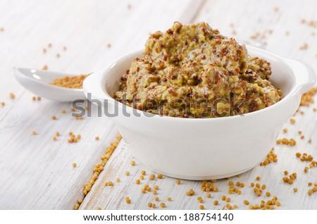 Mustard sauce on wooden table .Selective focus - stock photo