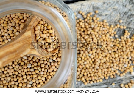 mustard seed in jar on wooden table