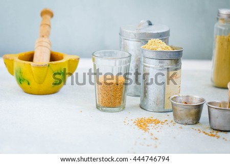 Mustard seeds glass cup with variety ingredients ready prepare mustard condiment sauce.  - stock photo