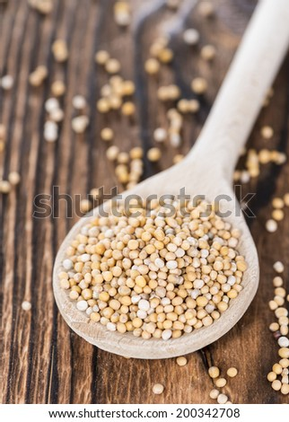 Mustard Seeds on a cooking Spoon (close-up shot)